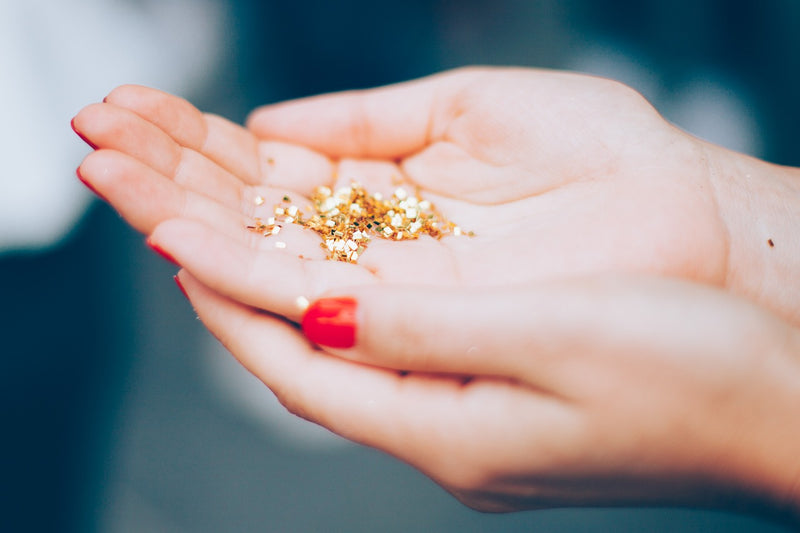 Woman with a handful of glitter to emphasise ban on single use plastic