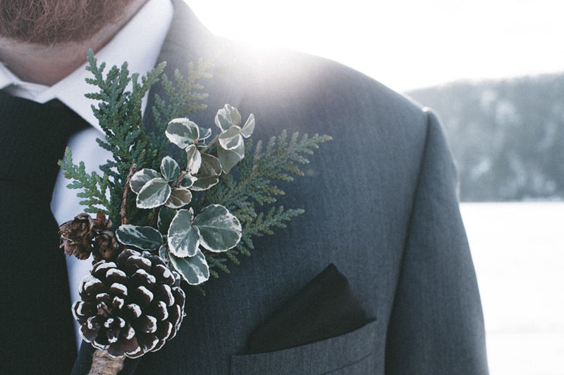Groom wearing a winter flower button hole for a December wedding