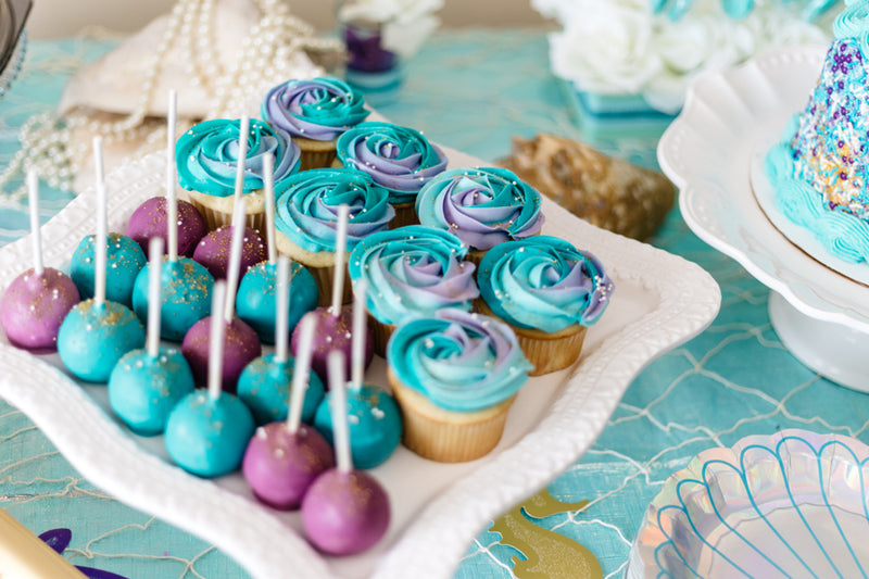 blue and purple multi coloured cakes on a pretty plate for small baby shower ideas