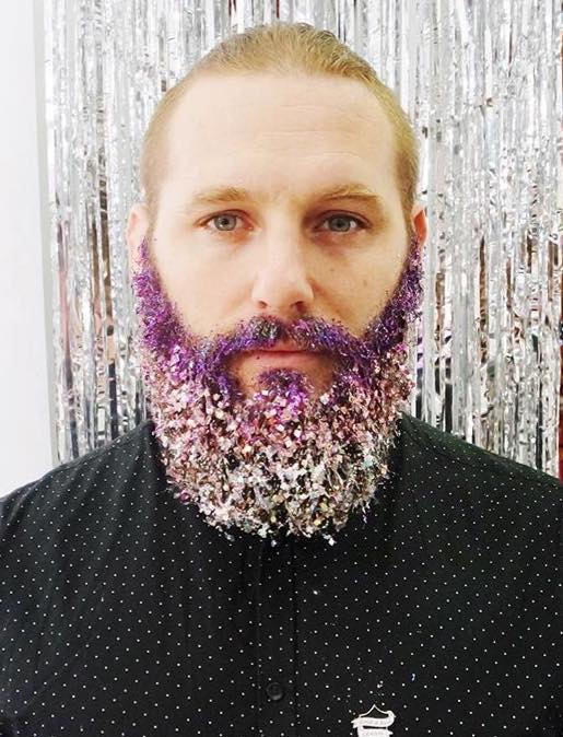 man with a purple glitter beard