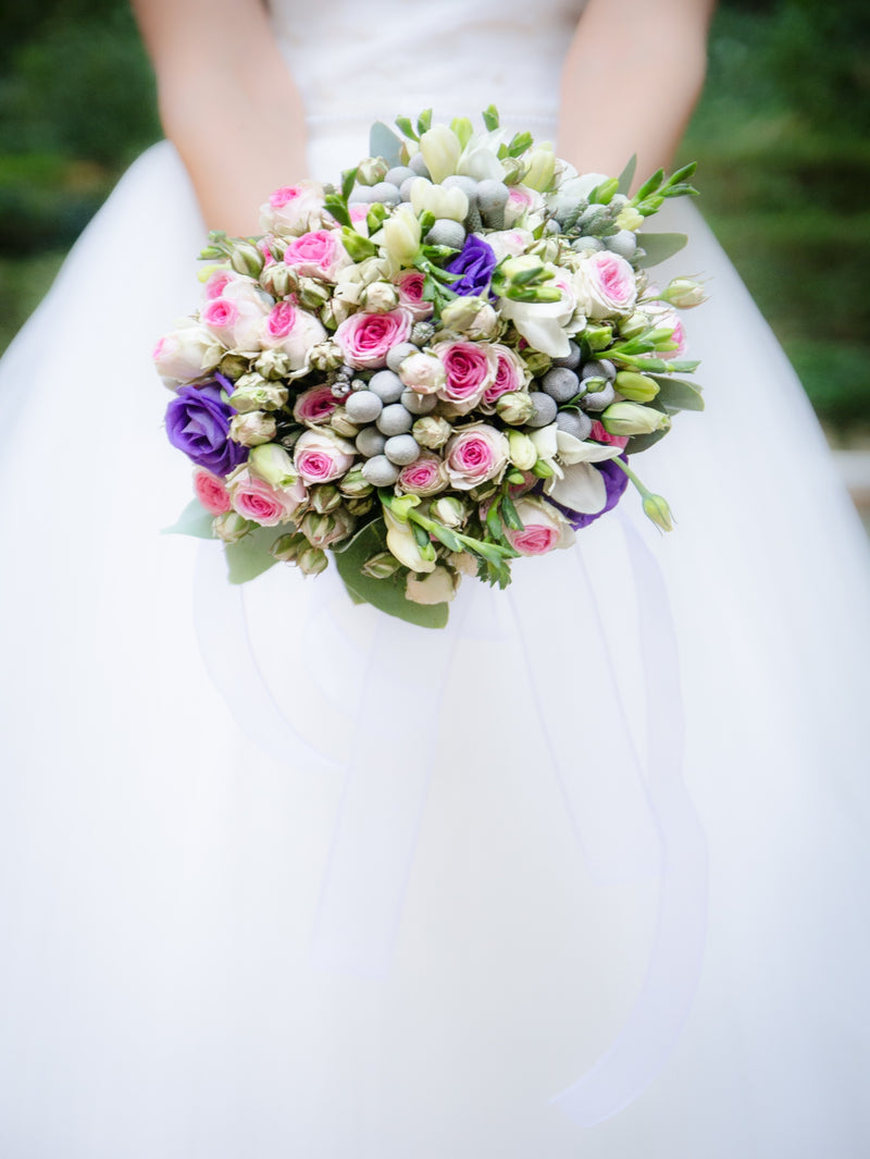 Planning Your Makeup For A Summer Wedding - Bride holding a colourful bridal bouquet.