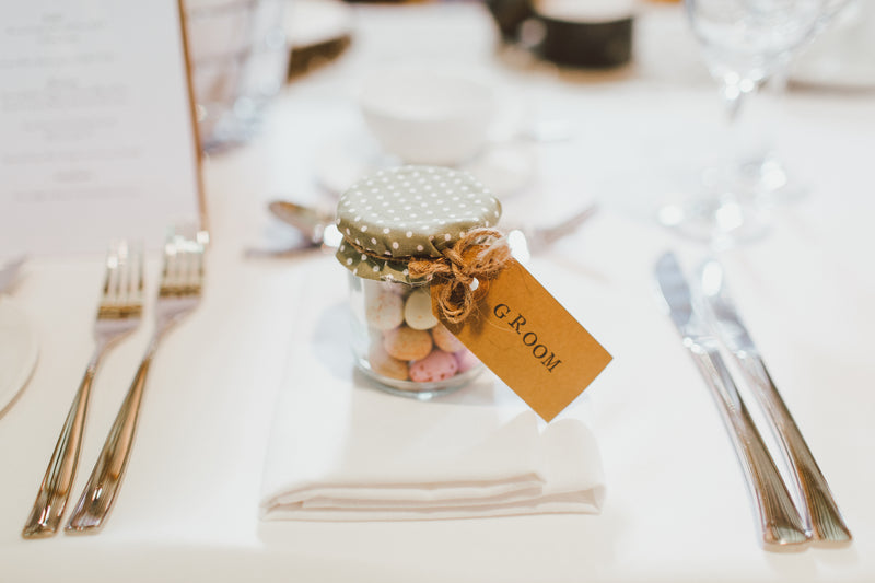 a tub of mini eggs as a guest place at a wedding