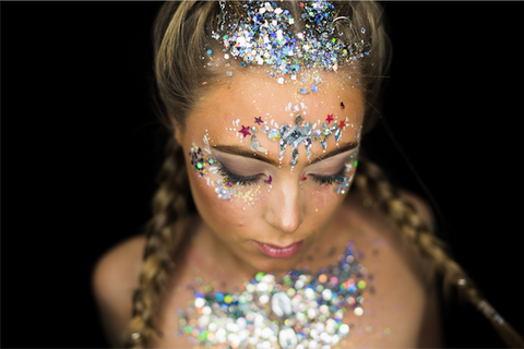 Woman with biodegradable glitter makeup on her face and body