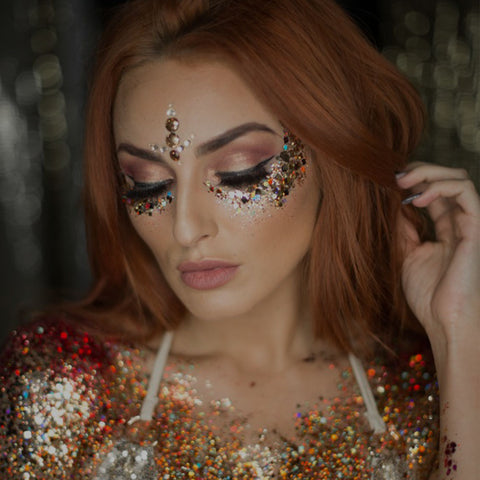 Woman with glitter on face and clothing