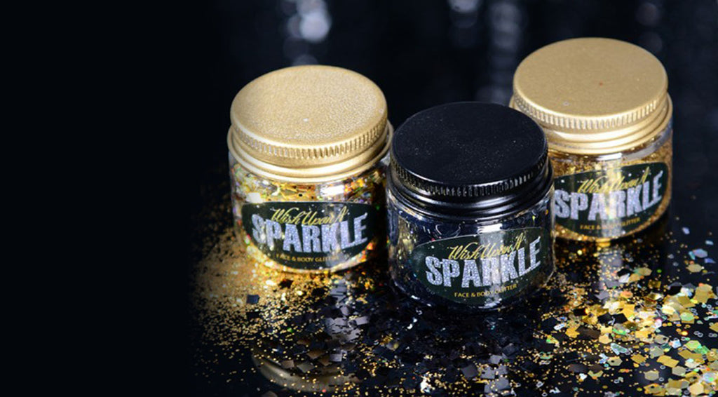 face glitter product pots in shades black and gold