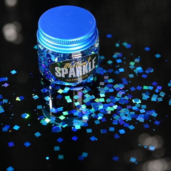 pot of blue glitter sprinkled on a surface