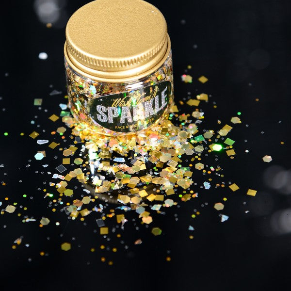 gold glitter pot sprinkled on a surface