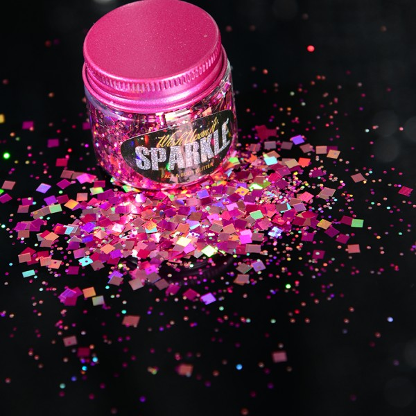 hot pink glitter pot sprinkled on a surface