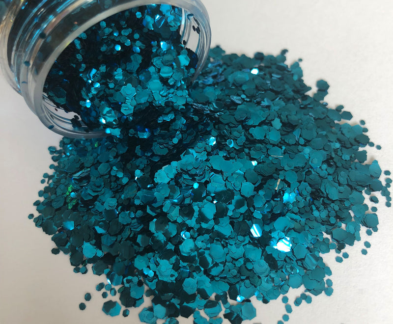 Ocean blue biodegradable glitter pouring out of pot