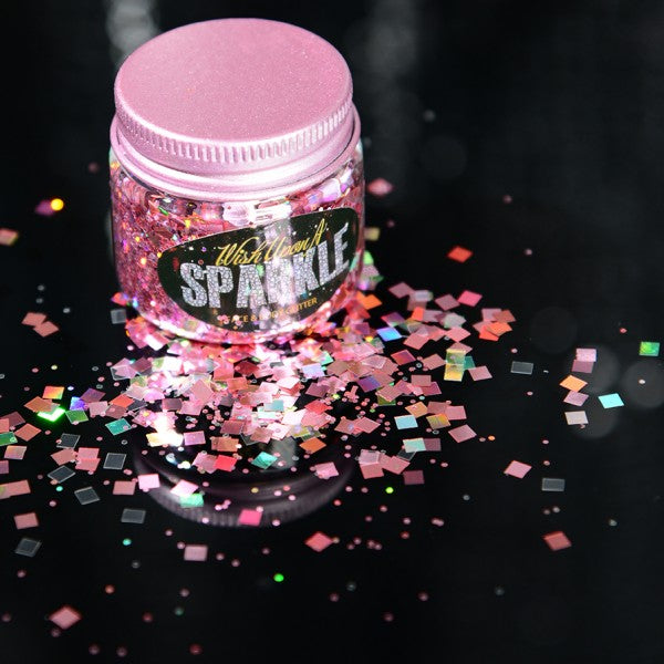 pot of pale pink glitter sprinkled on surface