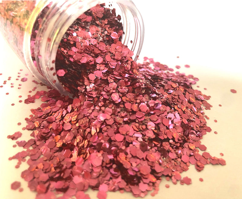 pink biodegradable glitter pouring out of pot