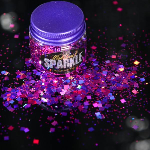 tub of purple face glitter that is sprinkled on the side