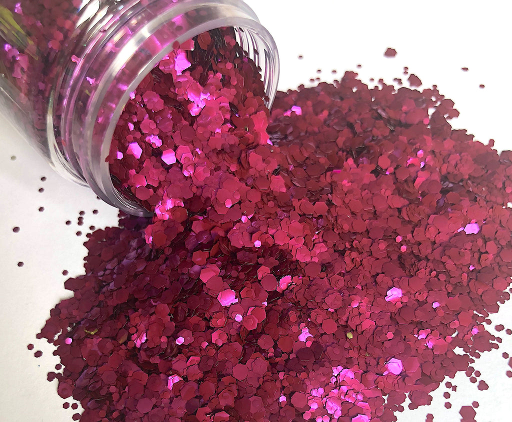 Purple biodegradable glitter pouring out of pot