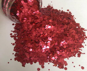 red biodegradable glitter pouring out of pot
