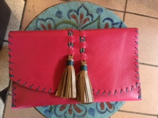 Handmade leather clutch by Heather Valdes