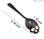 Black color skull teaspoon in stainless steel.