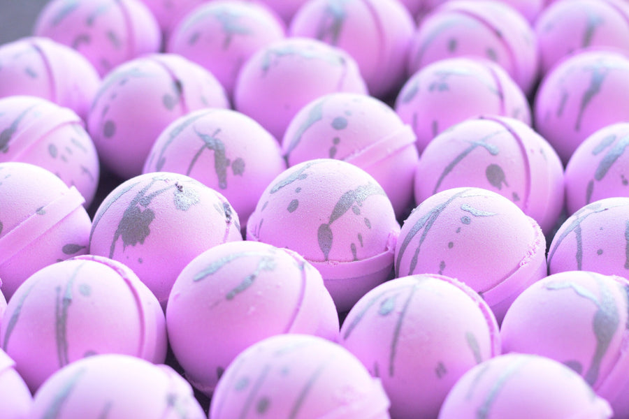 Sweet Sweet Paris is by far one of Ladyburg's most popular fragrances. These beautiful bath bombs have a pretty pink base to it with a shimmery silver drizzled on top!
