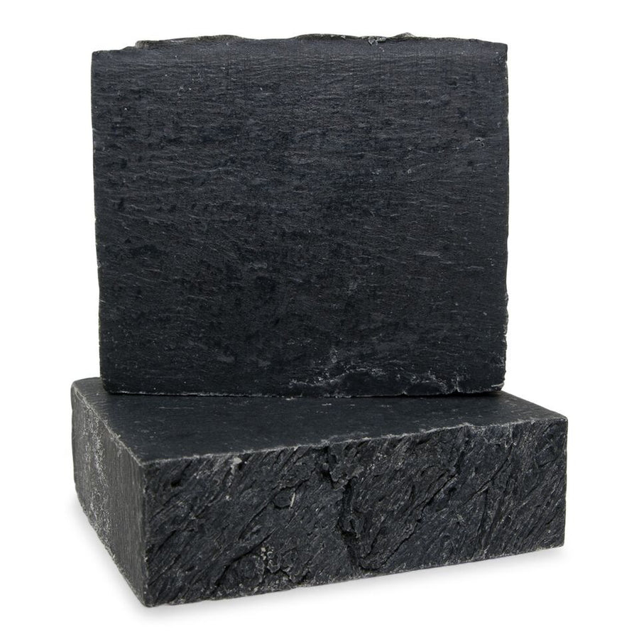 This soap bar is made with activated charcoal and fragranced with lavender essential oil.