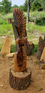 Chainsaw Carving Eagle Soaring. Chainsaw carved eagle, 3 foot tall wood chainsaw carving art.
