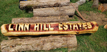 Load image into Gallery viewer, 5 ft long Chainsaw Carving Name Log. 2 BASE LOGS INCLUDED FREE,  Yard sign. Chainsaw carved cedar name log.