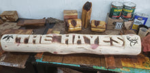 Load image into Gallery viewer, 5 foot Chainsaw carving Cedar name log. Custom art on log, yard name log