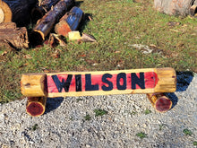 Load image into Gallery viewer, Chainsaw Cedar Name log. Custom Carved Name Log, base logs included