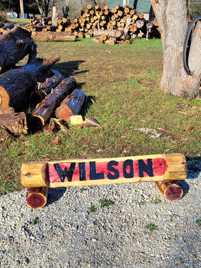 Chainsaw Cedar Name log. Custom Carved Name Log, base logs included