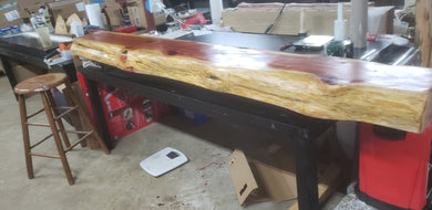 60 inches long. Cedar Live Edge floating fireplace mantel.