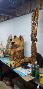 Chainsaw Carving Bear. Chainsaw carved bear in stump welcome sign. Welcome Bear Carving