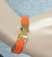 Load image into Gallery viewer, Hermes Clic H orange gold
