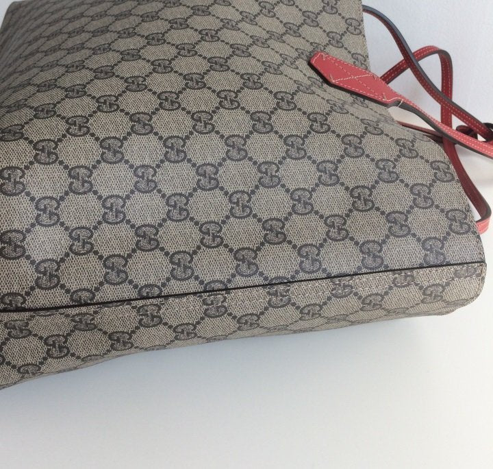566e21a7b63d ... Load image into Gallery viewer, Gucci reversible GG medium tote ...