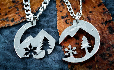 Mountain and snowflake necklace, interlocking coin