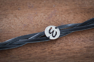 Custom Initial Cut on a dime and sewn on a woven Leather Bracelet