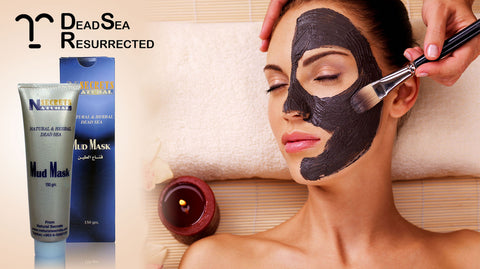Natural Secrets Dead Sea Mud Mask being applied to woman's face