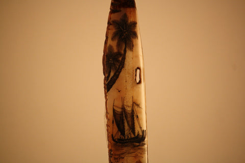 Fossilized Ivory Carving with Outrigger Canoe and Palm Trees