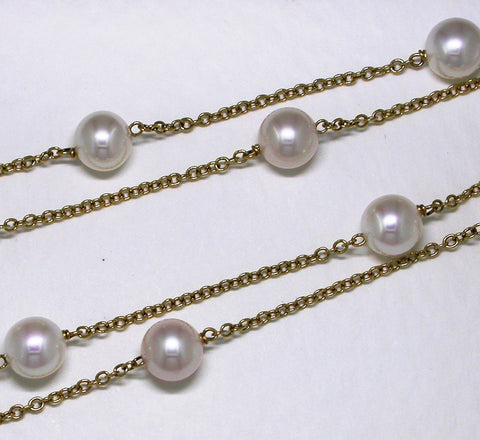 Pearl and gold chain necklace