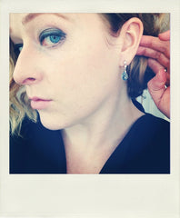 Emma wearing aquamarine briolette drop earrings
