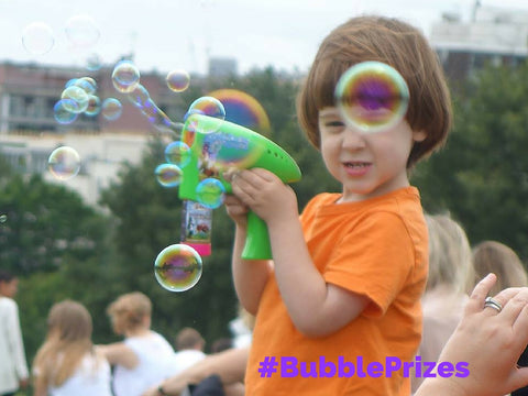 bubbliser bubblegun bubble inc bubbleinc little boy loving bubbles primrose hill London green bubblegun