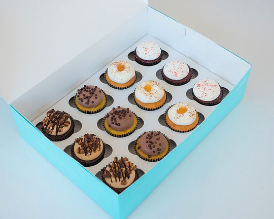 Our Vintage Cupcake Assortment features red velvet and chocolate peanut butter cupcakes. Only available at House of Clarendon in Lancaster, PA.