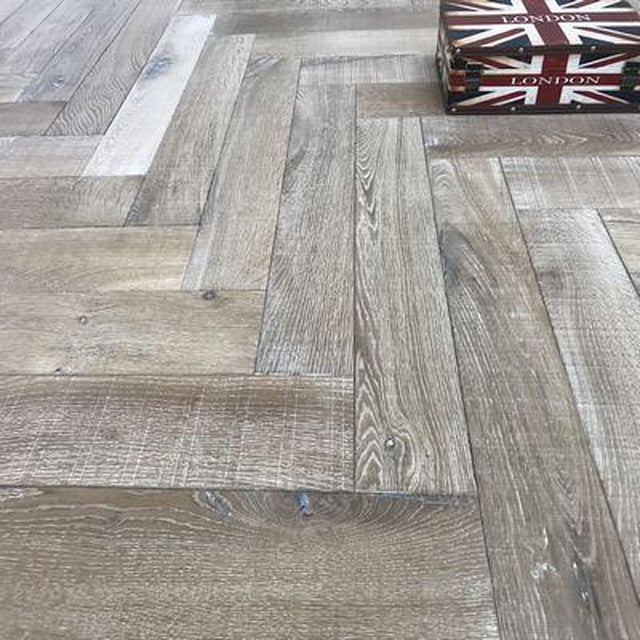 bespoke grey engineered oak herringbone saw marks