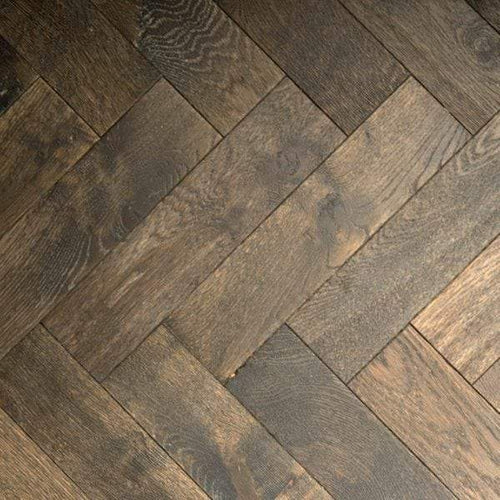 This view gives an overhead view showing a beautiful parquet oak herringbone floor in a dark warm chocolatey colour.  90mm wide these blocks are precision made and engineered for easy install