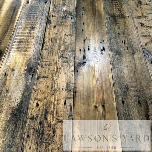 This beautiful reclaimed wood floor has come from an old mill and resembles a board that's been heavily used and distressed, brown with darker black area these wide boards would look amazing in a large room