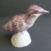 Earthenware Nuthatch on a white stand
