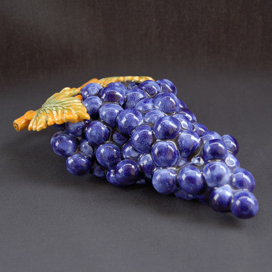 Bunch of earthenware blue grapes