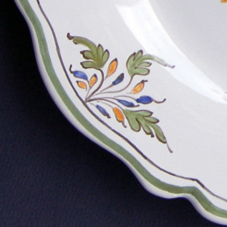 Feston plate with Moustier hand painted decoration