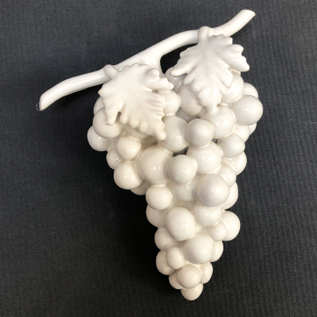Bunch of earthenware white grapes