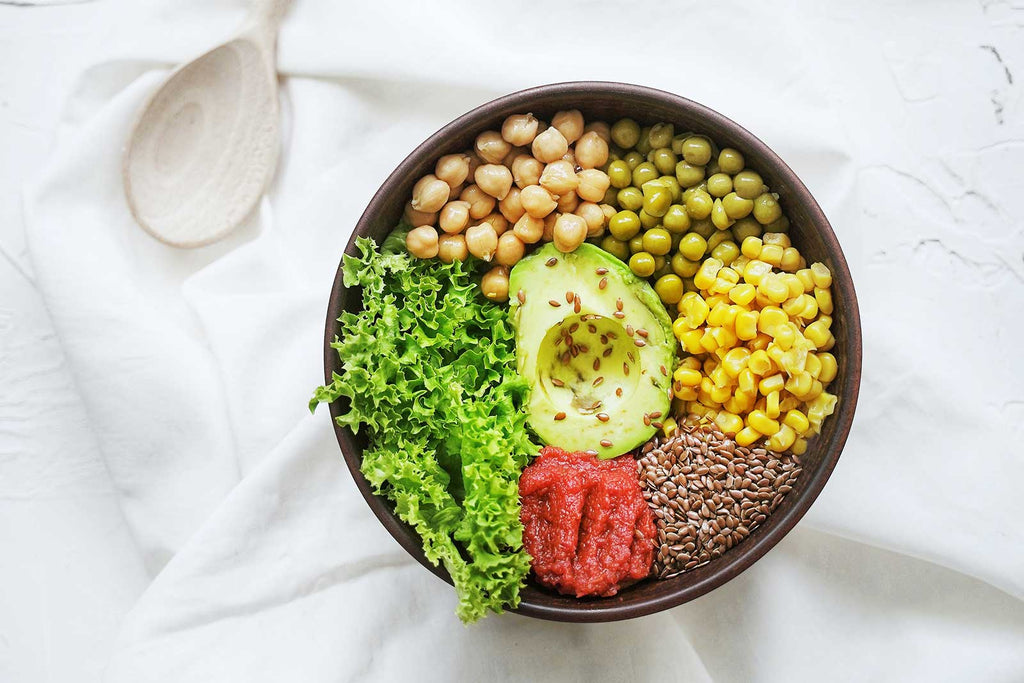 bowl of fresh veggies and legumes to help relieve constipation