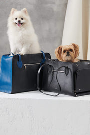 Cobalt Blue pet carrier for small dogs. Durable leather and canvas materials.
