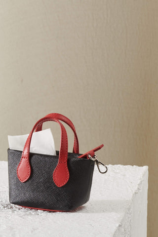 Red poop bag holder in red. A mini purse that acts like a poop bag holder.