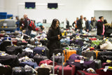 Travellers scour the baggage claim at Toronto's Pearson airport